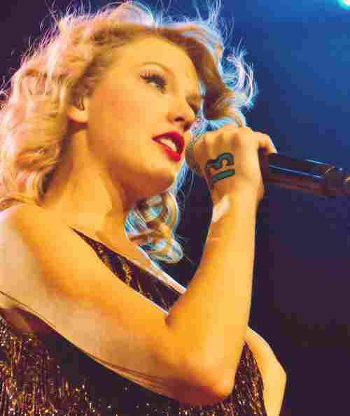 Swift won Hannah Montana as the female artist with the most songs on Billboard Hot 100 in a week.