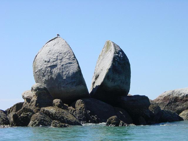 Split apple-shaped rock (New Zealand)