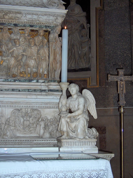Angel holding a candlestick