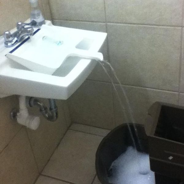 Use a dustpan as a bridge to fill the mop bucket